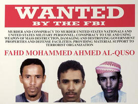 A wanted poster for Fahd Mohammed Ahmed al-Quso issued by the FBI is seen at FBI headquarters May 15, 2003, in Washington.