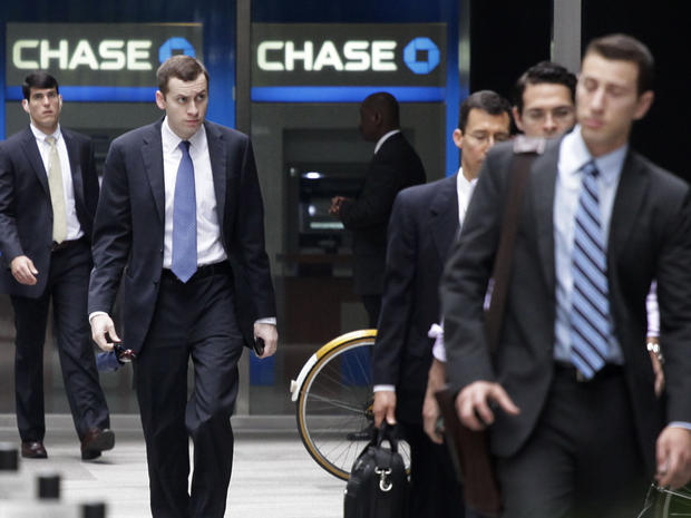 People arrive at JPMorgan Chase headquarters in New York Monday, May 14, 2012. JPMorgan, the largest bank in the United States, is seeking to minimize the damage caused by a $2 billion trading loss, disclosed Thursday by CEO Jamie Dimon.