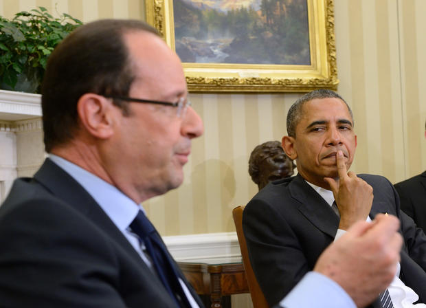 President Barack Obama meets with French President Francois Hollande in the Oval Office at the White House in Washington, Friday, May 18, 2012.