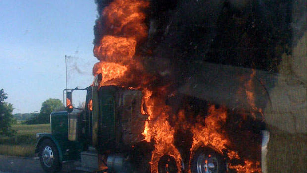 The semitrailer and its hay load on fire.