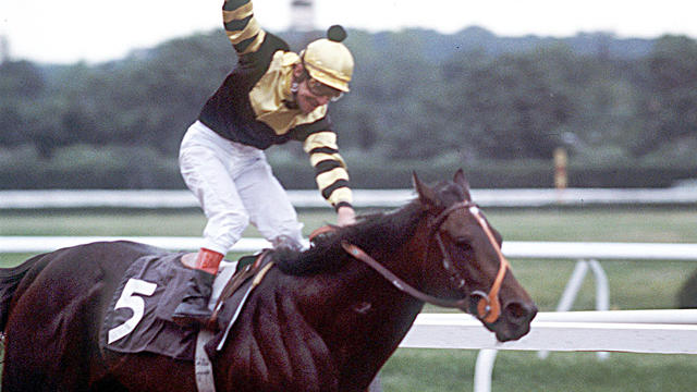 Seattle Slew, with jockey Jean Cruget aboard, wins the Belmont Stakes June 11, 1977, in Elmont, N.Y.