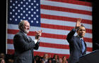 Former New Jersey Governor Jon Corzine (L) greets US President Barack Obama during a 2009 campaign really for Corzine in Camden, New Jersey