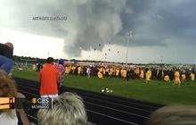 Apparent twister hovers near high school graduation