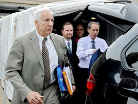 Former Penn State University assistant football coach Jerry Sandusky walks out of Centre County Courthouse after the first day of trial, in Bellefonte, Pa., Monday, June 11, 2012.