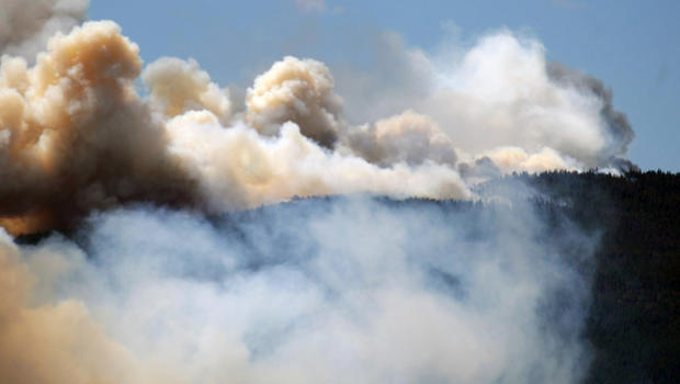 Smoke billows from a wildfire burning west of Fort Collins