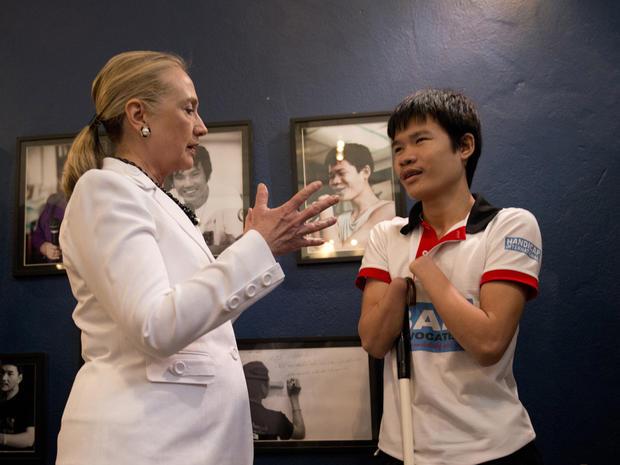 Hillary Clinton speaks with Phongsavath Souliyalat