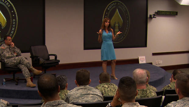 Lisa and Sgt. Mjr. Chris Faris tell audience of military members at MacDill Air Force Base in Tampa, Fla. about the impact on their marriage of his years in combat, and their struggle -- successful, so far -- to save their marriage, even as the military d