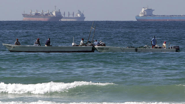 In this Thursday, Jan. 19, 2012 file photo, fishing boats are seen in front of oil tankers on the Persian Gulf waters, south of the Strait of Hormuz, off the shores of Ras Al Khaimah in the United Arab Emirates.