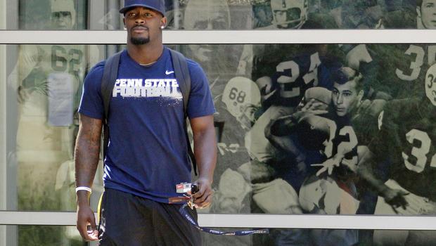 Penn State running back Silas Redd walks to the locker room following  Saturday's 41-7