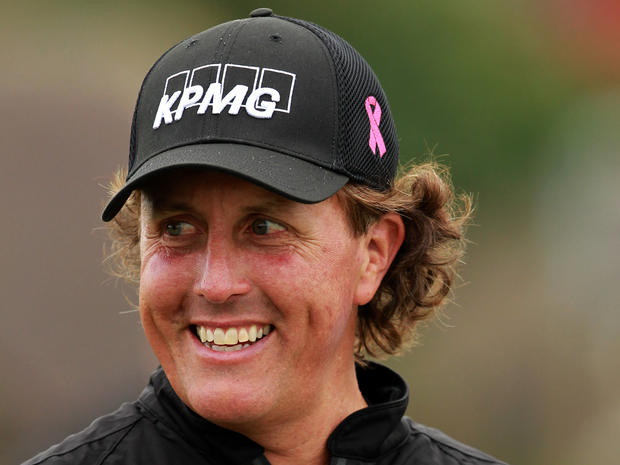 Phil Mickelson of the US prepares to tee off