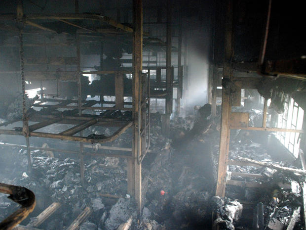 A totally charred coach from inside is seen of a passenger train