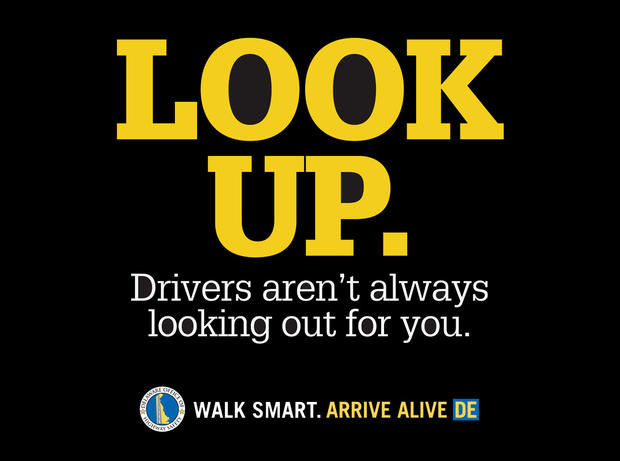 The Delaware State Office of Highway Safety created signs aimed at getting distracted pedestrians to look up from their mobile devices and watch where they're walking.