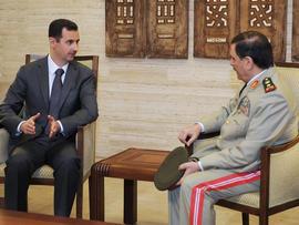 Syrian President Bashar Assad, left, meets Fahd Jassem al-Freij, Syria's new Defense Minister