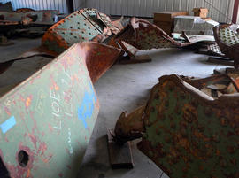 Rusting beams from the Interstate 35W bridge that collapsed Aug. 1, 2007 in Minneapolis are seen on the floor of a Minnesota transportation department garage in Oakdale, Minn. on Tuesday, July 31, 2012.