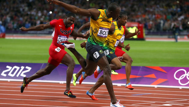 Usain Bolt sets Olympic record in men's 100-meter - CBS News