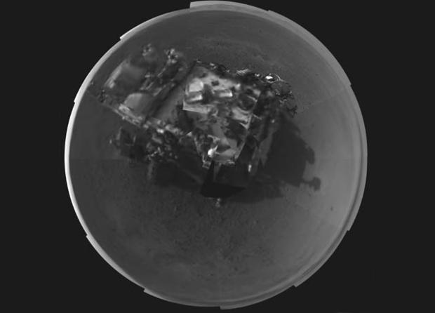 In this image released by NASA on Wednesday, Aug. 8, 2012, a self portrait of NASA's Curiosity rover was taken by its Navigation cameras, located on the now-upright mast. The camera snapped pictures 360-degrees around the rover.