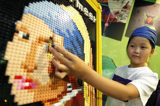 Kids build Lego masterpiece