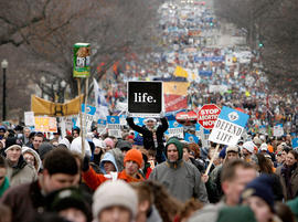 Thousands of anti-abortion demonstrators participating in the 'March for Life' walk up to Capitol Hill along Constitution Avenue on their way to the Supreme Court building January 22, 2008 in Washington, DC.