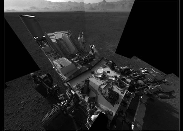 This full-resolution self-portrait shows the deck of NASA's Curiosity rover from the rover's Navigation camera. The back of the rover can be seen at the top left of the image, and two of the rover's right side wheels can be seen on the left. The undulatin