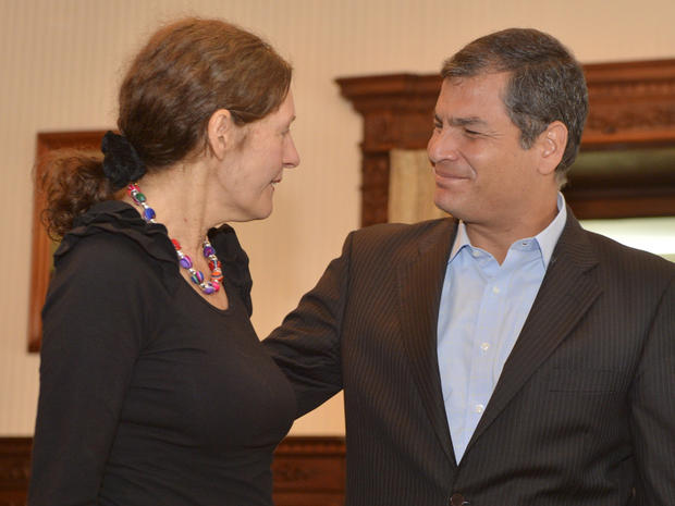 Ecuadorean President Rafael Correa greets Christine Assange