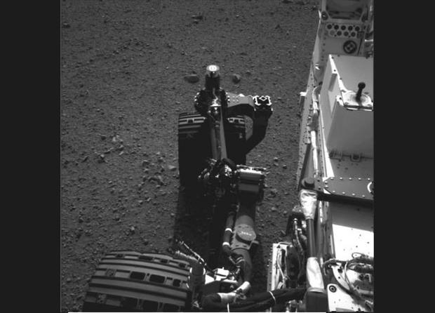 This still from a set of images shows the movement of the front left wheel of NASA's Curiosity as rover drivers turned the wheels in place at the landing site on Mars. Engineers wiggled the wheels as a test of the rover's steering