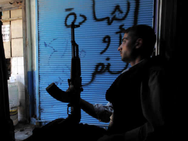 A Syrian rebel sits in a van in Aleppo