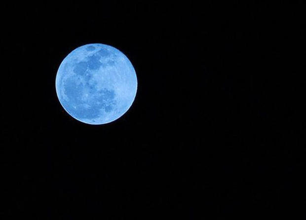 This photo of a blue moon was taken from Boca Raton, Fla., on New Year's Eve 2009. Blue moons aren't actually blue-hued, though that's not to say humans haven't seen blue and even green moons.