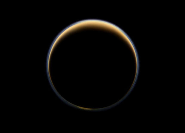 NASA's Cassini spacecraft looks toward the night side of Saturn's moon Titan and sees sunlight scattering its atmosphere, forming a colorful ring. The images were acquired on June 6, 2012, when Cassini was about 134,000 miles from Titan.
