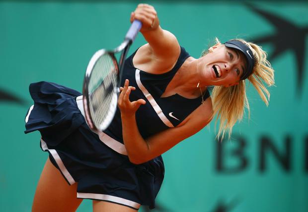Maria Sharapova of Russia serves for a backhand