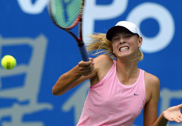 Maria Sharapova of Russia hits a return against Maria Sanchez Lorenzo