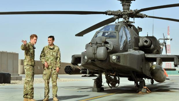 Prince Harry, left, being shown Apache flightline by member of his squadron at Camp Bastion in Helmand Province, Afghanistan on Sept. 7