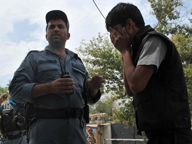 An Afghan man cries at the site of a suicide attack outside NATO headquarters in Kabul