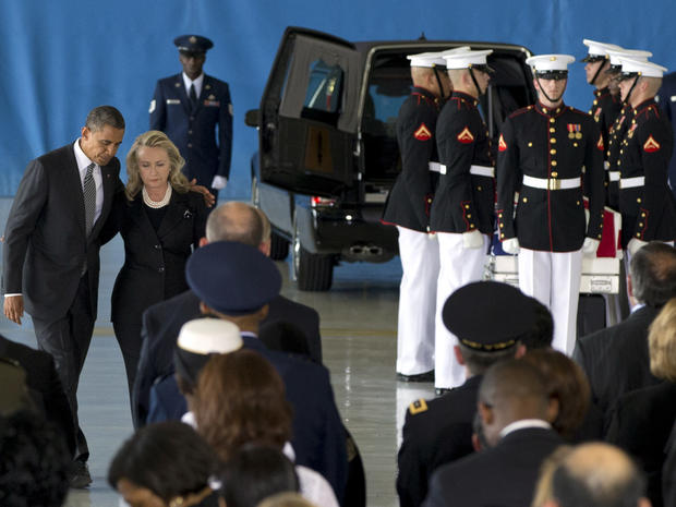 President Obama and Secretary of State Hillary Rodham Clinton walk back to their seats after speaking during a transfer of remains ceremony Sept. 14, 2012, at Andrews Air Force Base, Md., marking the return to the United States of the remains of four Americans killed in Benghazi, Libya.