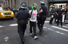 Occupy Wall Street protestor is arrested on Wall Street for blocking pedestrian traffic Monday
