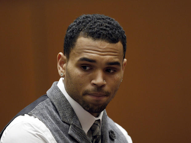 R&B singer Chris Brown appears in a Los Angeles courtroom Monday, Sept. 24, 2012. Judge Patricia Schnegg has ordered a further review of Chris Brown's community service and travel to determine whether Brown has violated the terms of his probation for the