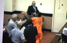 Watch: Inmate punches court-appointed attorney