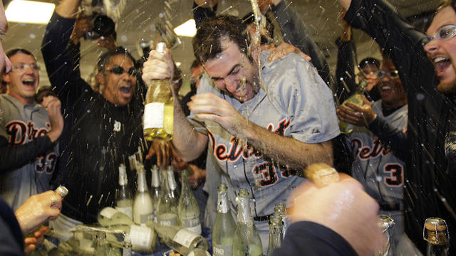 Detroit Tigers' Justin Verlander being  drenched with sparkling wine by teammates after beating Oakland A's
