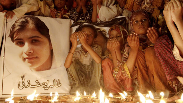 Pakistani children pray for the recovery of 14-year-old schoolgirl Malala Yousufzai, who was shot on Tuesday by the Taliban for speaking out in support of education for women, during a candlelight vigil in Karachi, Pakistan, Friday, Oct. 12, 2012.