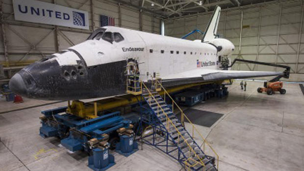 Retired space shuttle Endeavour in LAX hangar being prepared for 2 mph trip to final display spot, the California Science Center