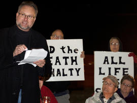 Reynold Nesiba, a death-penalty opponent, speaks to a crowd of protesters outside the South Dakota Penitentiary in Sioux Falls, S.D., on Monday, Oct. 15, 2012, in anticipation of the execution of Eric Robert. Robert pleaded guilty in the April 12, 2011, slaying of a guard during a failed prison escape and asked to be put to death, saying he would kill again. He was scheduled to die by lethal injection at 10 p.m. at the State Penitentiary in Sioux Falls_ the state's first execution in five years and only the second in more than half a century.