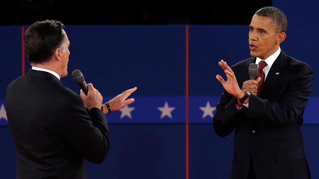 Republican presidential nominee Mitt Romney and President Barack Obama spar during the second presidential debate