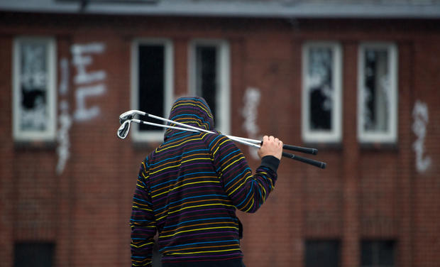 Golfers tee off in abandoned buildings