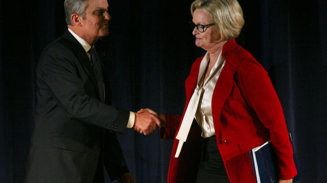 Republican Rep. Todd Akin and Democratic Sen. Claire McCaskill shake hands after the end of the second debate in the Missouri Senate race Thursday, Oct. 18, 2012, in Clayton, Mo.