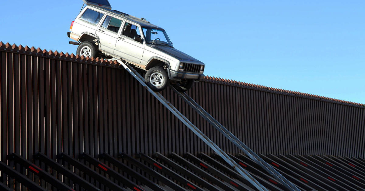 Suspected drug smugglers get stuck trying to drive over U.S.-Mexico border fence