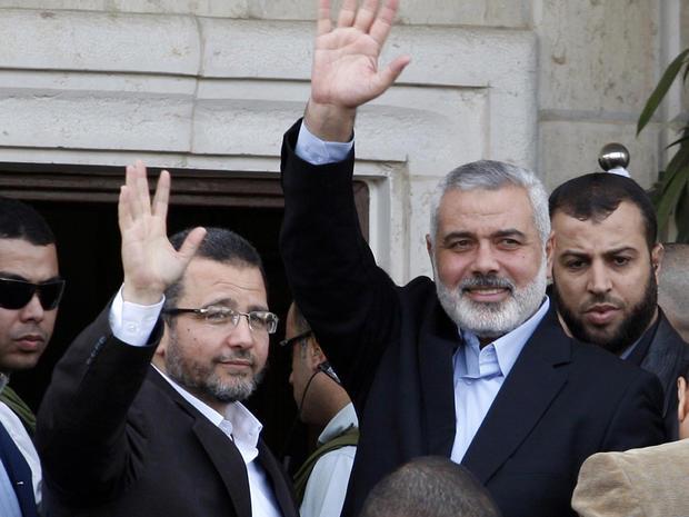 Gaza's Hamas Prime Minister Ismail Haniyeh, right, and Egyptian Prime Minister Hesham Kandil, in Gaza City