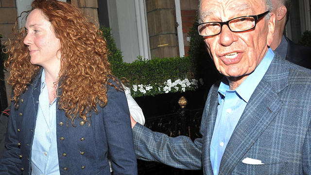 News International chief executive Rebekah Brooks and News Corp. chairman Rupert Murdoch are seen outside his central London residence July 10, 2011.