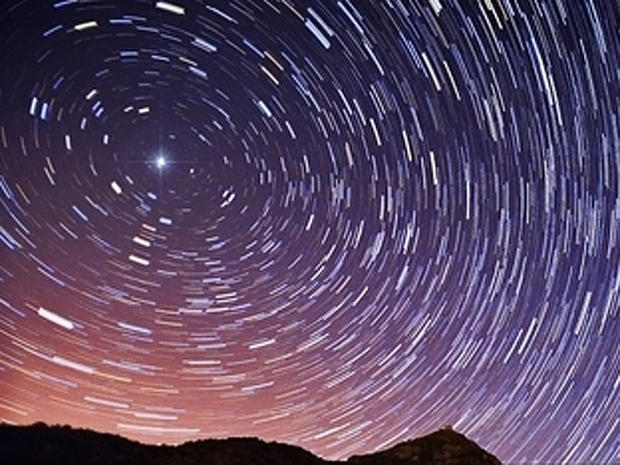 This long-exposure photo shows how the North Star, Polaris, stays fixed in the night sky as other stars appear to move during the night due to Earth's rotation.