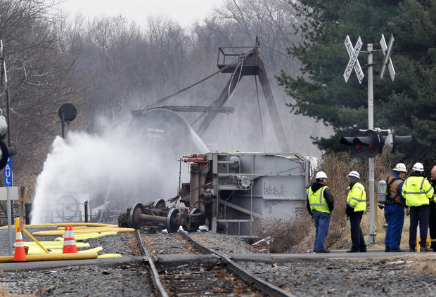 NJ train derailment tips tankers, sickens dozens