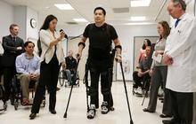 Robotic suit enables paraplegics to walk