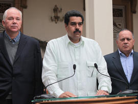 "In this photo released by Miraflores Press Office, Venezuela's Vice President Nicolas Maduro, center, addresses the nation on live television flanked by Oil Minister Rafael Ramirez, left, and National Assembly President Diosdado Cabello at the Miraflores presidential palace in Caracas, Venezuela, Wednesday, Dec. 12, 2012. Maduro said that Venezuela's President Hugo Chavez will face a ""complex and hard"" process after undergoing his fourth cancer-related operation in Cuba on Tuesday. Over the weekend, Chavez named Maduro as his chosen political heir."